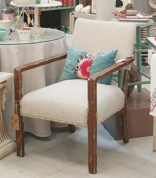 Distressed chair with linen upholstery