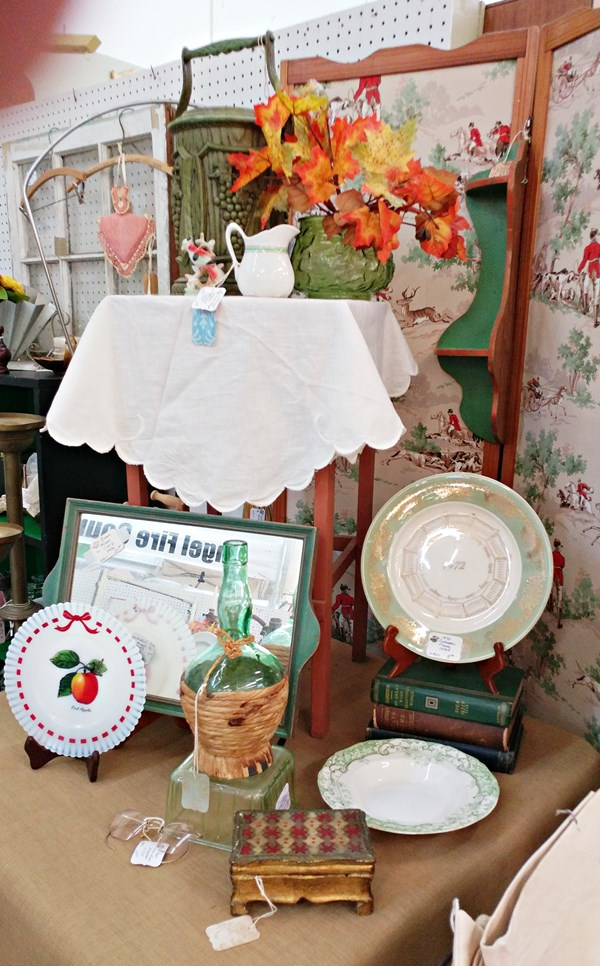 Table in the booth with green and red items