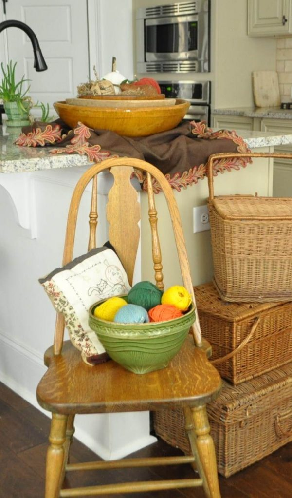 Fall color yarns in a bowl, Halloween pillow and other fall and Halloween decorations.