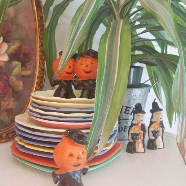 Pumpkin head men and witch candles