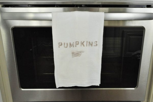 Flour sack towel stamped with the word Pumpkins.