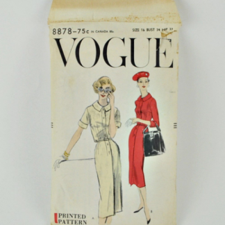 Vogue 8878. A wiggle dress pattern dated 1957. Buttons up front from hip, has short or 3/4 length sleeves and Peter Pan style collar.