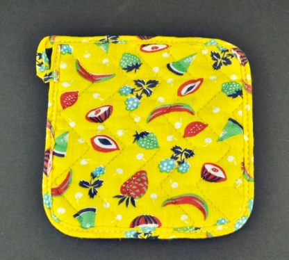 Back of vintage Velvo Flour advertising potholder. Back is a fruit print with yellow background.