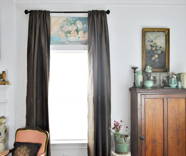 Painting above window and mint green pottery