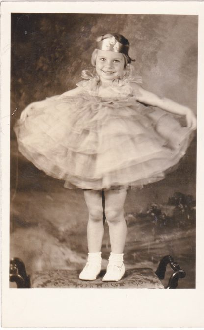 Real photo postcard of little girl in a pageant or dance costume